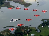 F22 And Red Arrows