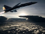 Fighter Aircraft Flying Out Of The Clouds