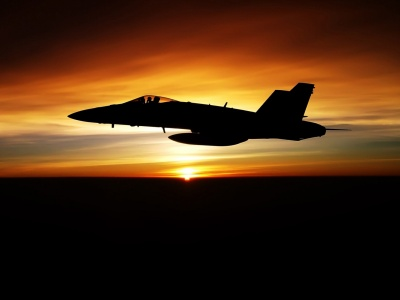 Fighter Flying In Dusk Sky (click to view)